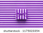 purple gift box on violet... | Shutterstock . vector #1175023354