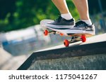 skateboarder legs riding on... | Shutterstock . vector #1175041267