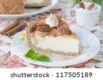 slice of cheesecake with apples and caramelized pecans - stock photo