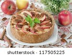 cheesecake with apples and caramelized pecans - stock photo