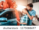a guy shows a new car to... | Shutterstock . vector #1175088697