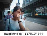 woman feel sick on hong kong... | Shutterstock . vector #1175104894