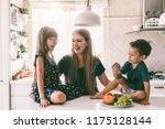 mom with her two children... | Shutterstock . vector #1175128144
