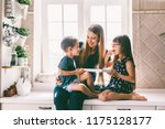 mom with her two children... | Shutterstock . vector #1175128177