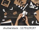 halloween preparation. hands... | Shutterstock . vector #1175129197