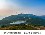 wind turbine against mountain | Shutterstock . vector #1175140987