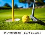 mini golf yellow ball with a... | Shutterstock . vector #1175161087