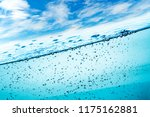many air bubbles in water close ... | Shutterstock . vector #1175162881