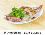 fresh grilled shrimps served on ... | Shutterstock . vector #1175166811