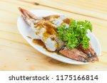 fresh grilled shrimps served on ... | Shutterstock . vector #1175166814