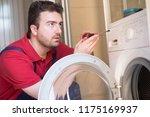 professional worker repairing... | Shutterstock . vector #1175169937