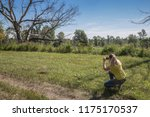 the girl photographs the... | Shutterstock . vector #1175170537