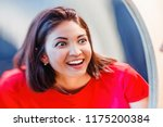 a woman laughs and looks at the ... | Shutterstock . vector #1175200384