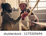 Boxing Coach Tying Head Guard...