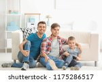 male gay couple and adopted boy ... | Shutterstock . vector #1175286517