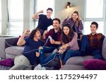 friends playing video games in... | Shutterstock . vector #1175294497