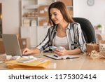 young woman with laptop... | Shutterstock . vector #1175302414