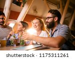 four cheerful friends with... | Shutterstock . vector #1175311261