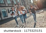 group of young people are... | Shutterstock . vector #1175325151