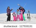 Family on the ski - stock photo