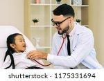 doctor pediatrician welcoming ... | Shutterstock . vector #1175331694