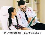 doctor pediatrician welcoming ... | Shutterstock . vector #1175331697