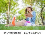 smiling asian woman having a... | Shutterstock . vector #1175333407
