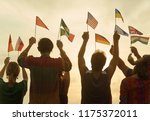 hands up with flags. silhouette ... | Shutterstock . vector #1175372011