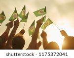 hands holding brazil flags.... | Shutterstock . vector #1175372041