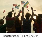 silhouettes of people holding... | Shutterstock . vector #1175372044