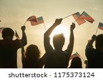 crowd of people holding... | Shutterstock . vector #1175373124