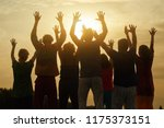 happy family raised hands up on ... | Shutterstock . vector #1175373151