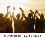 greeting the sun. people with... | Shutterstock . vector #1175373181