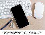 modern smartphone on a keyboard ... | Shutterstock . vector #1175400727