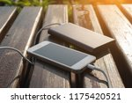 the power bank charges the... | Shutterstock . vector #1175420521