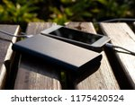 bank of power and phone on the... | Shutterstock . vector #1175420524