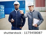 two engineers wearing hardhats... | Shutterstock . vector #1175458087
