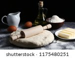 raw dough with rolling pin ... | Shutterstock . vector #1175480251