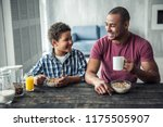 afro american father and son in ... | Shutterstock . vector #1175505907