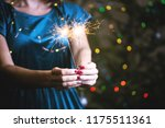 girl holds bengal lights  ... | Shutterstock . vector #1175511361