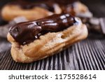 cakes eclairs decorated with... | Shutterstock . vector #1175528614