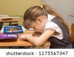 a schoolgirl with a wrong... | Shutterstock . vector #1175567347