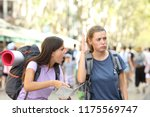 angry backpackers arguing... | Shutterstock . vector #1175569747
