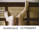 bare feet of woman leaning on... | Shutterstock . vector #1175580694