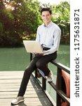 cheerful asian businessman... | Shutterstock . vector #1175631871