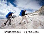 two people is crossing glacier... | Shutterstock . vector #117563251