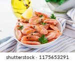 boiled  shrimps or prawns on a... | Shutterstock . vector #1175653291