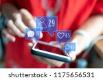 holding smartphone with social... | Shutterstock . vector #1175656531