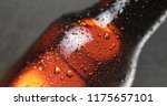 brown full bottle of beer with... | Shutterstock . vector #1175657101