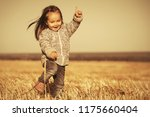 happy two year old girl wearing ... | Shutterstock . vector #1175660404